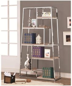 Use this unique tapered Bookcase by Coaster Furniture in your home to keep books or display your favorite collectibles. The metal frame in a chrome finish contrasts with staggered shelves in a weathered grey finish add a rustic element for a modern casual Wood And Metal Shelves, Metal Bookcase, Wood Bookshelves, Open Bookcase, Home Office Furniture, Modern Furniture, Chest Furniture, Furniture Ideas, Cool Beds For Kids
