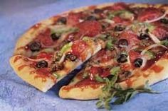 Buffalo Supreme Pizza gives you a kick with buffalo wing sauce with pepperoni and sausage.  #pizza #recipe #buffalo #pepperoni #sausage #spicy