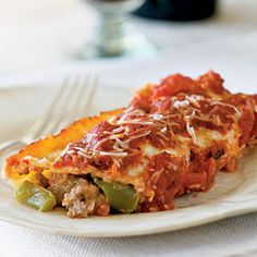 Sausage Stuffed Manicotti from CookingLight.com  ... only 292 calories per serving    Stuffed manicotti recipes can be high in calories, but turkey sausage and other lower fat ingredients keep the numbers down in this family-friendly Italian dish.