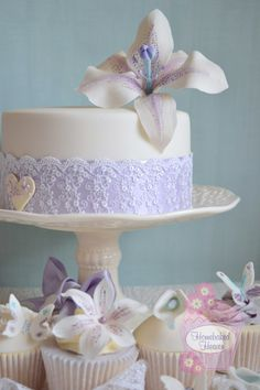 Wedding cake and wedding cupcakes with lilies, butterflies and lace. Lilac with Tiffany Blue accents. Royal iced designs inspired by the bride's Lusan Mandongus wedding gown.