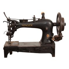 """WWI Singer Tent and Leather Sewing Machine, USA 1900-1915  This isn't your great-grandmother's sewing machine...this is signed """"Property of Defense Plant Corporation; an instrument of the United States Government"""" and was most likely used to produce leather goods and tents during World War I."""