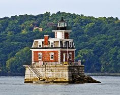 The Hudson-Athens Lighthouse, built in 1873-74, located in the middle of the Hudson River between Hudson, NY and Athens, NY. Unlike most other lighthouses, this one is actually a complete house, containing bedrooms, a kitchen, a dining room and a sitting room. NY