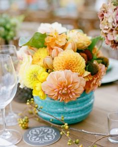 Liz and Allen's Mexico-Inspired California Wedding was complete with centerpieces of vibrant ceramic vessels holding cheerful arrangements of dahlias, tulips, ranunculus, and hydrangeas.