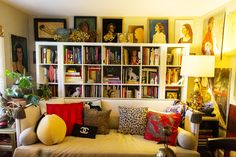 I always decorate with bookcases behind the couch.  =)