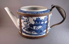 .:. The broken handle of this c. 1800 Chinese porcelain teapot was replaced with a metal handle.