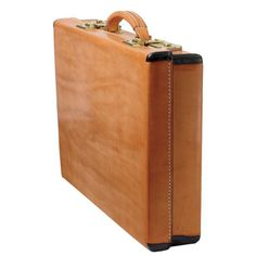 This briefcase lives up to its namesake's reputation with phenomenal craftsmanship, the finest natural materials and handsome styling. The outer shell is crafted of genuine 15oz. skirting leather, the same beautiful and rugged leather used in our famous saddle. Brass hardware with a double combination lock secures the case. Natural leather lining; two legal size open pockets, two small open pockets, pen pocket, ID window and card pocket. made to order in Kingsville, Texas by King Ran
