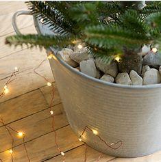 Weihnachtsbaumhalter mit Steinen