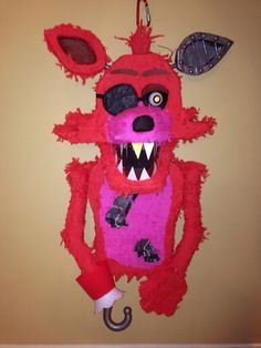 Finally finished and ready for the party! Homemade Foxy from FNAF piñata