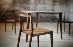 Beautiful simple wooden chair. Does anybody know who designed or manufactures it?