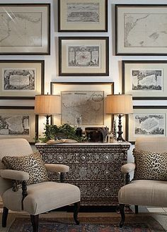 Leopard print combined with sepia toned nautical prints and a shell encrusted cabinet beach house decor.