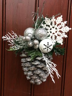 40 awesome pinecone crafts and projects - A girl and a glue awesome pinecone crafts and projectsSeasonal Simplicity Holiday Home TourLarge pinecones mounted on silver candlesticks on a mantel decorated for ChristmasGorgeous Frosty PineconesThis Pine Cone Christmas Decorations, Christmas Pine Cones, Pinecone Ornaments, Christmas Tree Ornaments, Christmas Diy, Pine Cone Crafts, Christmas Crafts, Office Christmas Party, Silver Candlesticks