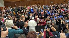 People stand up on chairs, push each other out of the way, and hold their selfie sticks high to capture a photo of Pope Francis. This moment reflects the great influence that the Pope can have on people, but at the same time shows how technology driven our culture is. The audience appeared to be more focused on taking pictures instead of viewing the Pope with their own eyes. Photo by David Litz.
