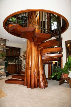 Collection of spiral staircase designs suitable for small homes. The design of a spiral staircase will not take up much space. Tree Interior, Interior And Exterior, Hobbit House Interior, Staircase Design, Wood Staircase, Staircase Ideas, House Staircase, Modern Staircase, Log Homes
