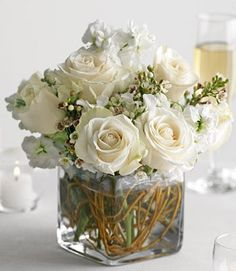 roses, filler flowers like waxflower and exposed grapevine in vases??? too much maybe???