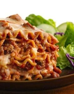 Slow-Cooker Lasagna ~ This lasagna was excellent. Highly reccommend. Superb taste, so easy, the noodles come out just right, not mushy or hard. It holds it shape when served, yet is tender and moist through.