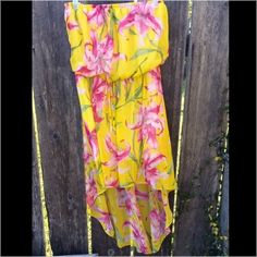 "Super cute yellow dress Strapless high-low yellow dress with floral print. Sash around waste.  Shell & lining 100% polyester. Front length 27"", back length 41"". Like new. Dresses Strapless"