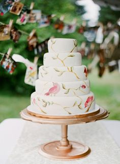 Delicate handpainted birds. So lovely! See more Wedding Cake Trends for 2013 at Equally Wed - A gay, lesbian and allied wedding website.