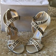 """Jimmy Choo heels Jimmy Choo heel in perfect condition. One heel has a little mark. I took a pic of the scratch and posted it. Cream and metallic mesh leather. Only worn twice. Comes with a Jimmy Choo shoe bag. Heel size 4"""" but very comfortable Jimmy Choo Shoes Heels"""