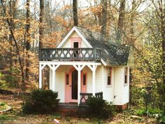 Inside this Victorian-style playhouse is a bright playspace fit for any young girl's imagination. A ladder leads to a loft.
