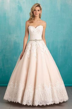 Soft hem lace echoes the sweetheart bodice of this strapless ballgown wedding dress. Allure, Spring 2016