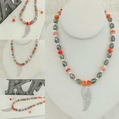 Check out this item in my Etsy shop https://www.etsy.com/listing/521184387/sparkly-orange-and-silver-wing-necklace