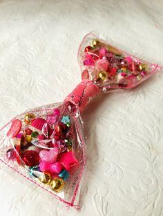 I made a bow similar to this one when I was a young teenager. For whatever reason, this project has stuck with me, twenty-five years late. Kids Hair Bows, Diy Bow, Decoden, Candyland, How To Make Bows, Diy Flowers, Girly, Diy Crafts, Crafty