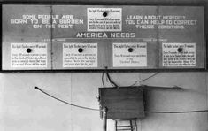"""A sign with flashing lights used with the first exhibit at a fitter families contest reads: """"Some people are born to be a burden on the rest. Learn about heredity. You can help to correct these conditions."""""""