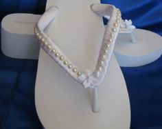 Items similar to Ivory Flip Flops or White Flip Flops with Pearls and Rhinestones Beach Wedding Sandals Ivory Bridal Sandals Ivory Wedding Sandals on Etsy Beach Wedding Sandals, Bridal Sandals, Bridal Flip Flops, White Flip Flops, Ivory Wedding, Flipping, Crafty, Pearls, Etsy