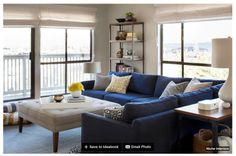 Blue sofa/sectional, with light cushioned coffee table