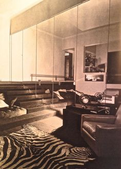 Interior design by Jean-Michel Frank showing his designed furniture's and animal printed rug.