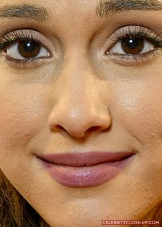"""ariana grande close up view shows she has regular skin. like anyone else, that is coated in lots of make-up.  Celebs show the public a """"perfect"""", unrealistic image, not truth, so stop comparing yourself to an image that is not real."""