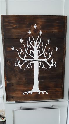 A Wood carving I created for a friend: The White Tree of Gondor. First time using a burning technique and white for contrast.