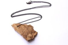 Minimalist Lake Erie spalted driftwood live edge handmade chain necklace by thejewelmule #Jewelry #Necklaces #Pendants #asymmetric #driftwood #minimalism #driftwoodnecklace #minimalistnecklace #woodenjewelry  #woodenpendant #woodgrain #organic #asymmetricnecklace #rawjewelry #woodjewelry #reclaimedwood