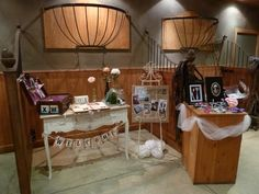Stables set up with pictures, flowers, vintage suitcase for cards and messages