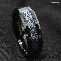 Our best selling ring.  Dragons are a universal symbol of deity and power. This men's tungsten ring captures their reverence of the Celtic People for the Sacred