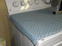 Sew a magnetic (insulated) ironing mat for the top of the dryer. No ironing board needed for quick pressing jobs.