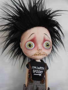 Custom Blythe Doll Work includes - Face sand matted and makeup sealed with Msc Flat. Lips, nose, teeth and philtrum carved. Eyes are glued into place so they do not turn with a pullstrings like the normal Blythes. Hair is a fake fur wig glued into place. Licca body added.
