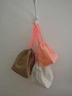 Peach, brown and faux wood drawstring bags with neon orange cord. by scraphilldesigns on Etsy Drawstring Bags, Travel Bags, Cord, Peach, Buy And Sell, Neon, Colour, Orange, Handmade