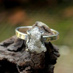 Sterling silver hand textured ring with genuine lightly coloured rough diamond