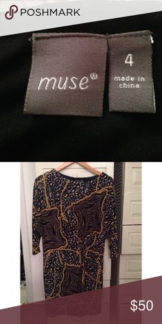 Boutique cheetah patterned dress Size M. Animal print inspired dress with black, green and gold tones! 3/4 sleeves. Great material, no signs of wear and tear - only worn twice. Muse Refined Dresses