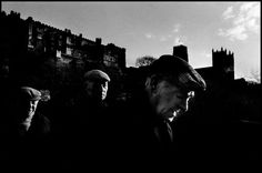 Magnum Photos - Ian Berry GB. England. Durham. Three men in cloth caps, probably coal miners, with Durham Castle and cathedral in the background. 1974