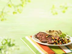 Understood literally as grilled beef, Carne Asada is practically a Mexican staple. This rendition is simple, with a bold sauce and a fresh corn salsa to accessorize. Find dried ancho chili powder in the spice section of major grocers. Sweet Red Pepper, Tri Tip, Corn Salsa, Grilled Beef, Carne Asada, Peppers And Onions, Beef Recipes, Chili Powder, Favorite Recipes