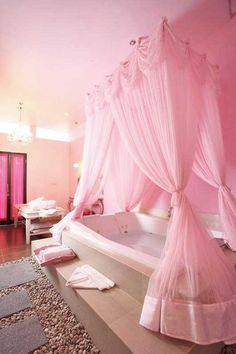 Could this be any dreamier? Bathtub with pink curtains...