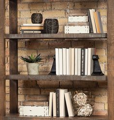 When styling bookshelves, vary the heights of accessories for a more interesting look