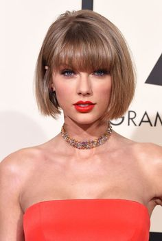 """While T-Swift was busy raking in awards at the Grammys, she also debuted a new bob and bangs on the red carpet. Consider her bold look further proof that she's a proud member of the """"short hair don't care"""" club...and we can't get enough."""