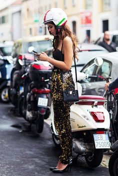 Sequined trousers paired with a simple black top