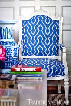 A Louis-XVI-style open arm chair is given a fresh look in blue and white. - Photo: Dustin Peck / Design: Jack Fhillips and Sally Altizer