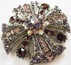 vintage brooch - this looks like the things Avon had - really heavy, they'd make a dress droop. Antique Brooches, Antique Jewelry, Vintage Jewelry, Victorian Jewelry, Vintage Clothing, Look Vintage, Vintage Pins, Vintage Beauty, Rhinestone Jewelry