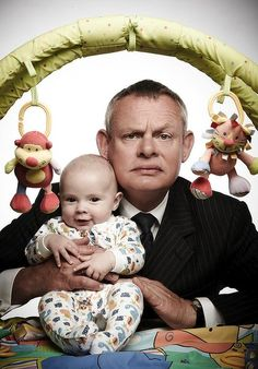 """Martin Ellingham """"Doc Martin"""" --This makes me laugh...the baby has such as wonderful smile (must have his mother's genes :) ) and Martin soooooooo grumpy...and we KNOW he has such a wonderful smile, too!!"""