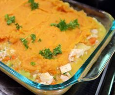 Mashed sweet potatoes baked on top of a chicken and vegetable shepherd's pie. It's Whole30 comfort food heaven!